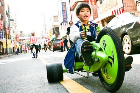 korean boy rides through suwon ecomobility festiva